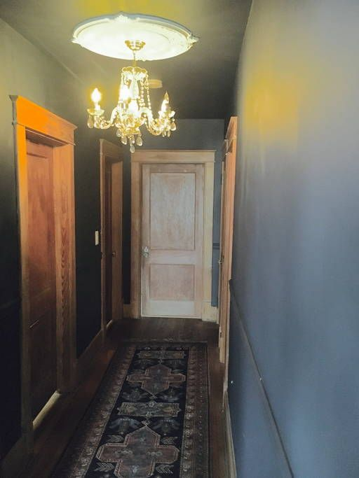 Benjamin Moore hale navy hallway with wood trim and doors, crystal