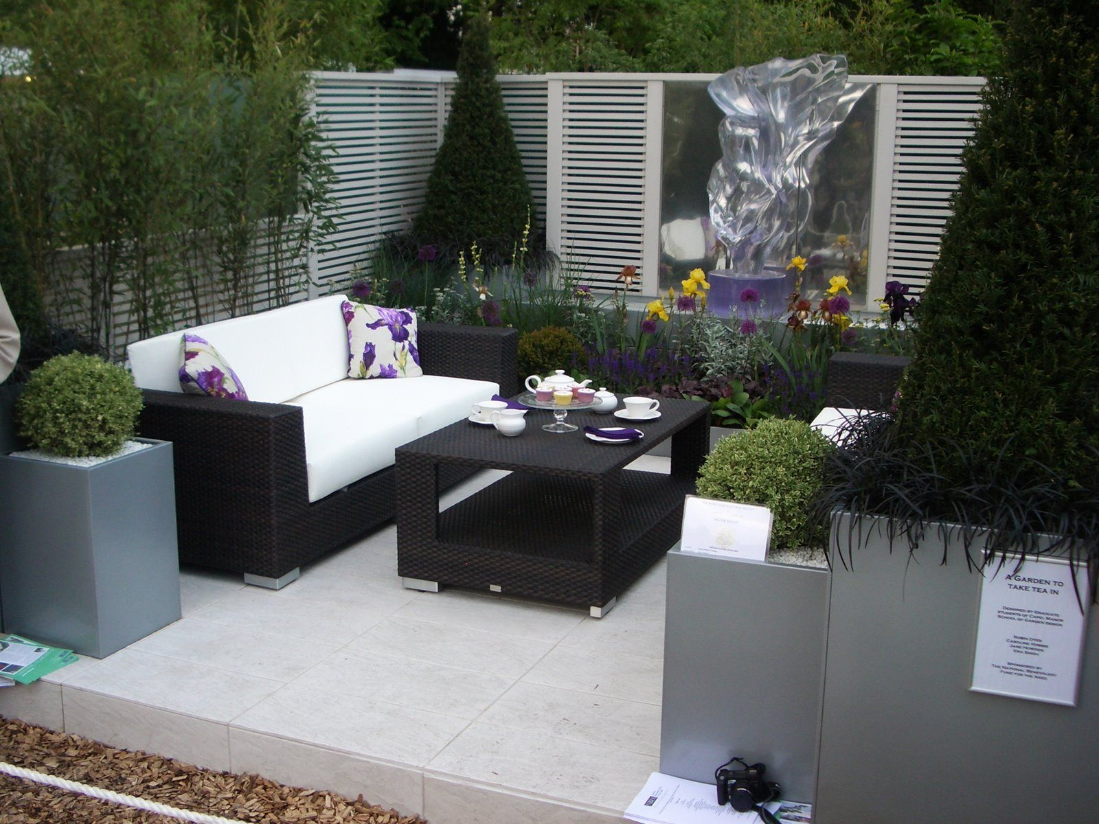 Small Outdoor Balcony Design with Modern Sofa and Square Table