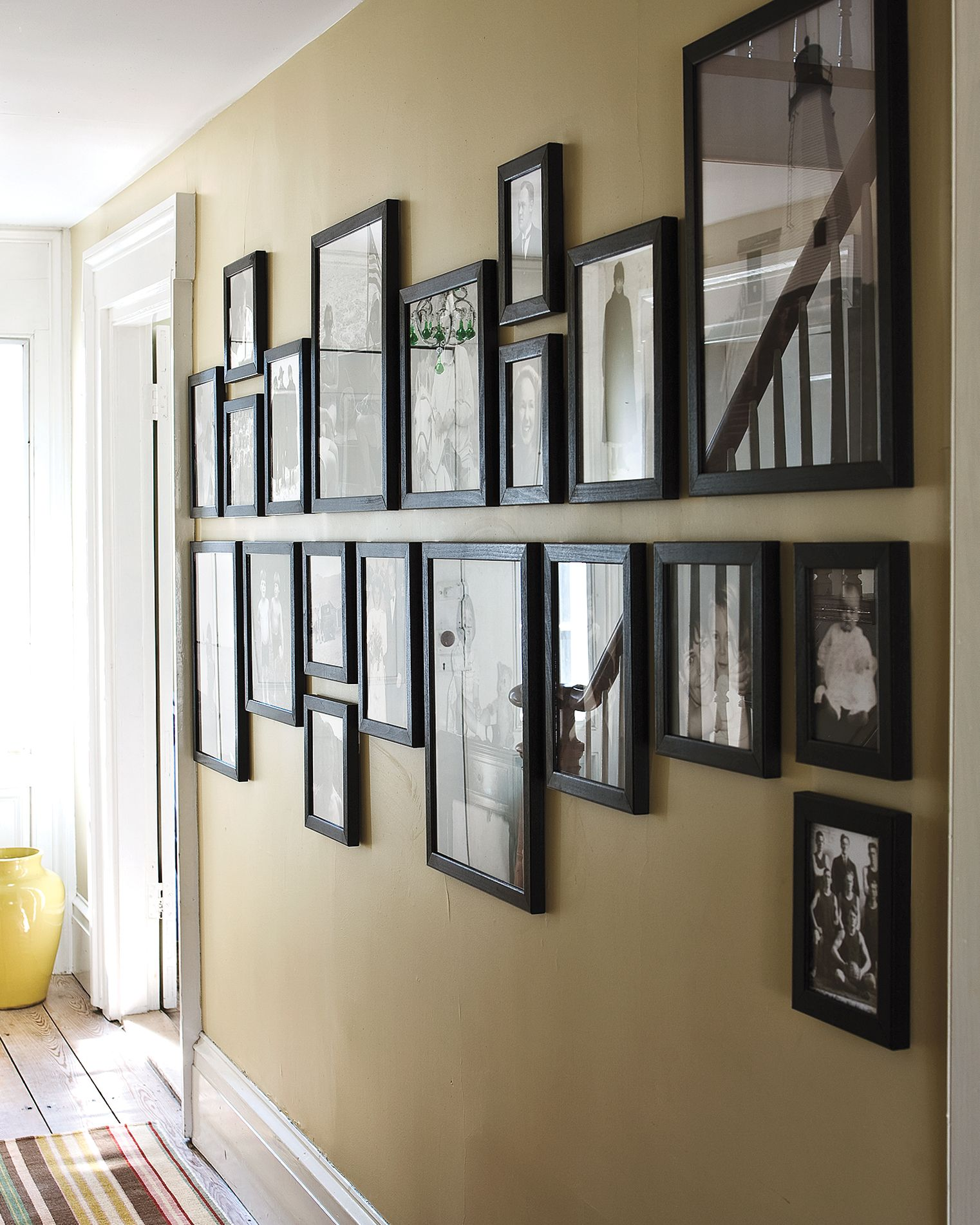 12 Brilliant Ways To Decorate A Blank Wall Wall Decor Living Room Photo Wall Display Family Photo Wall