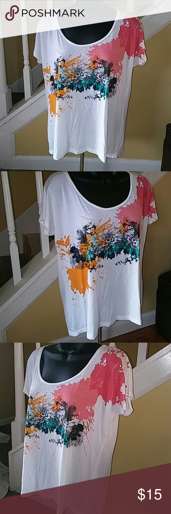 Beautiful top by Zara Small Beautiful White with multi color splash and black floral print on front. Zips up back with zipper.  If you have any questions please feel free to message! Reasonable offers will be entertained....just use the offer button. Zara Tops Blouses