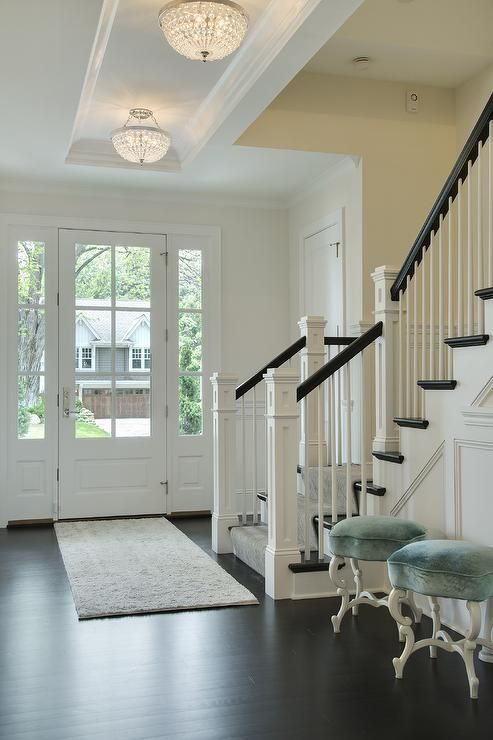 Chic Foyer Features A Long Tray Ceiling Accented With Beaded Flush Mounts Illuminating Pair Of