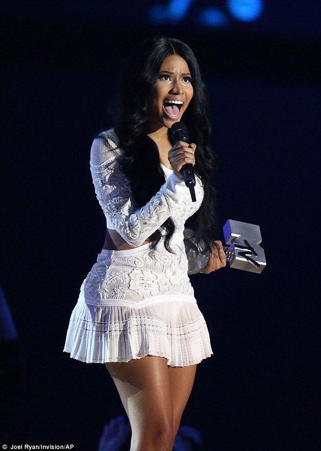 Nicki Minaj stuns in a rhinestone bralet and spectacular