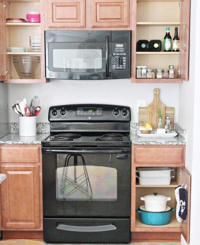 kitchen cabinet organization into zones cabinets by the oven kitchenorganization on organizing kitchen cabinets zones id=22183