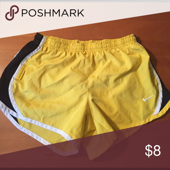 Nike dri-fit exercise shorts-medium girls. Yellow and black exercise shorts. Would fit a very small woman Nike Shorts