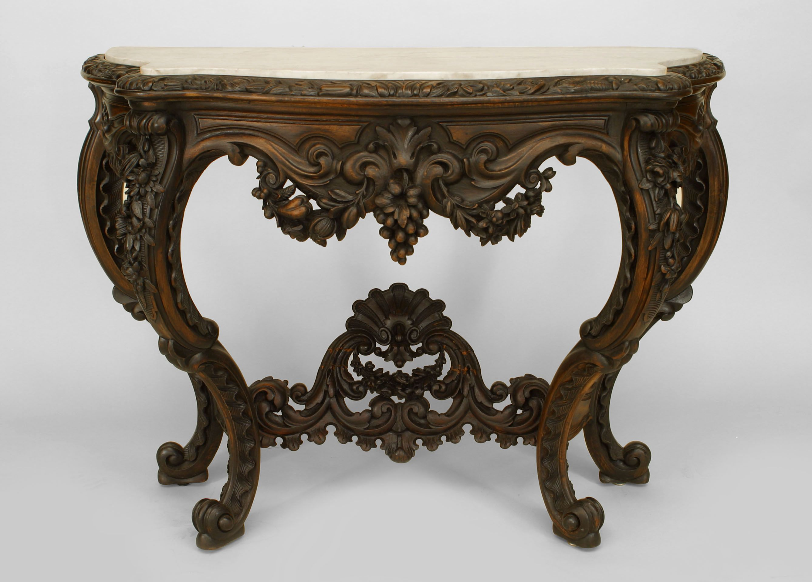 American Victorian ebonized and console table with floral carved