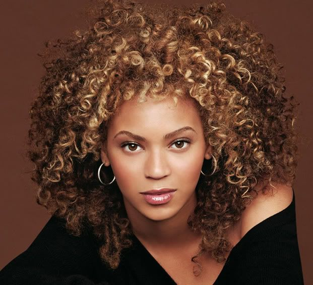 Beyonce natual set hair with color highlights.