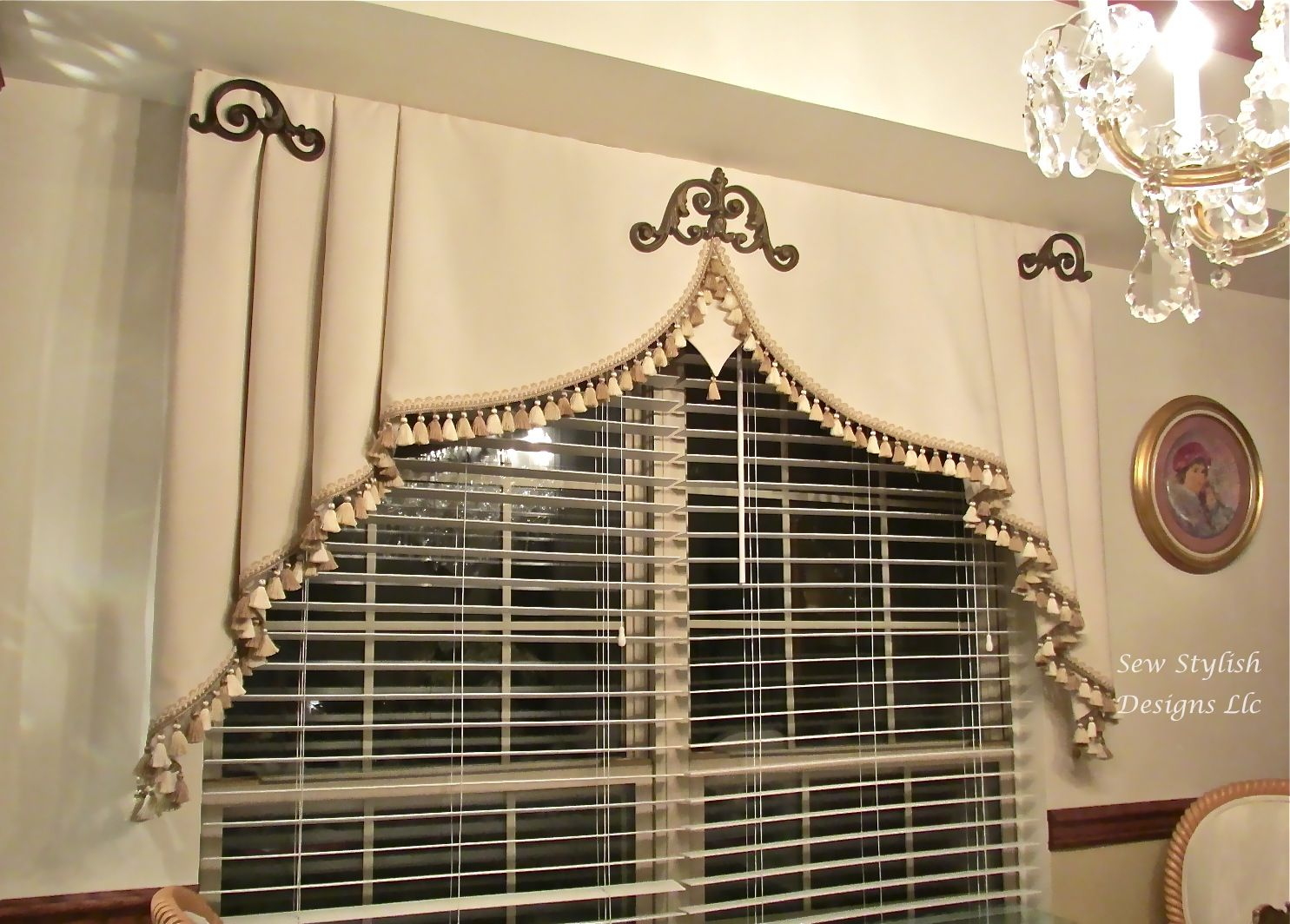 Triangle window coverings  embellished milan valance with iron scrolls and tassel fringe in