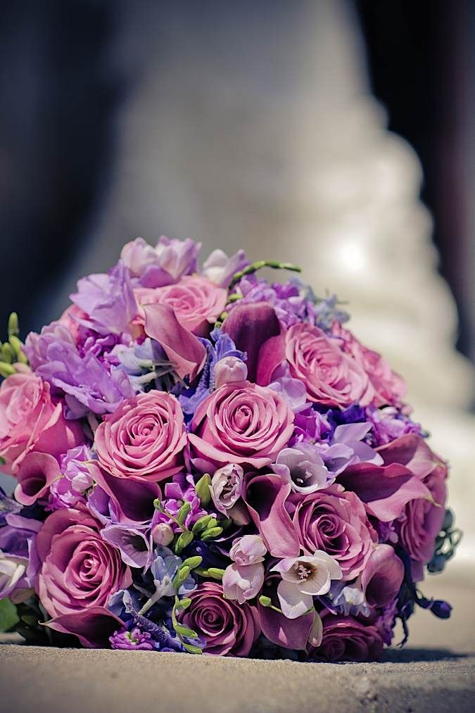 bridal bouquet on aisle (mini callas, freesia, roses)