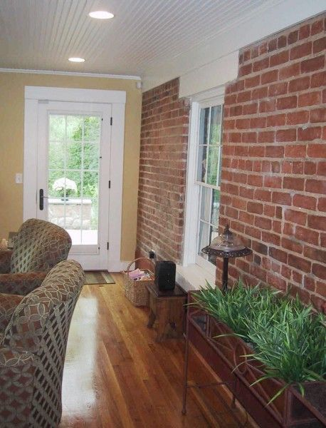 Interior sunroom addition with exposed brick wall porch for Sunroom interior walls