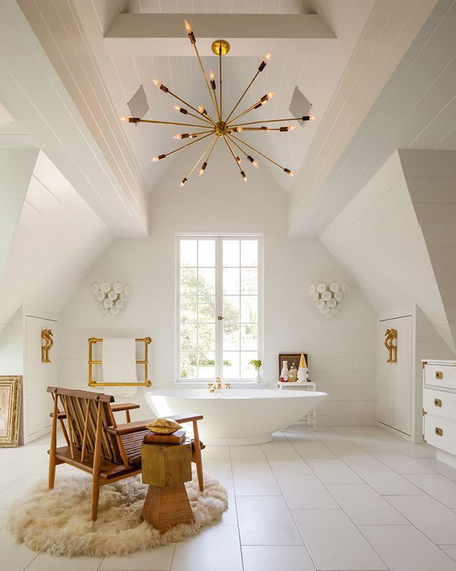 Spacious and bright attic bathroom with soaking tub
