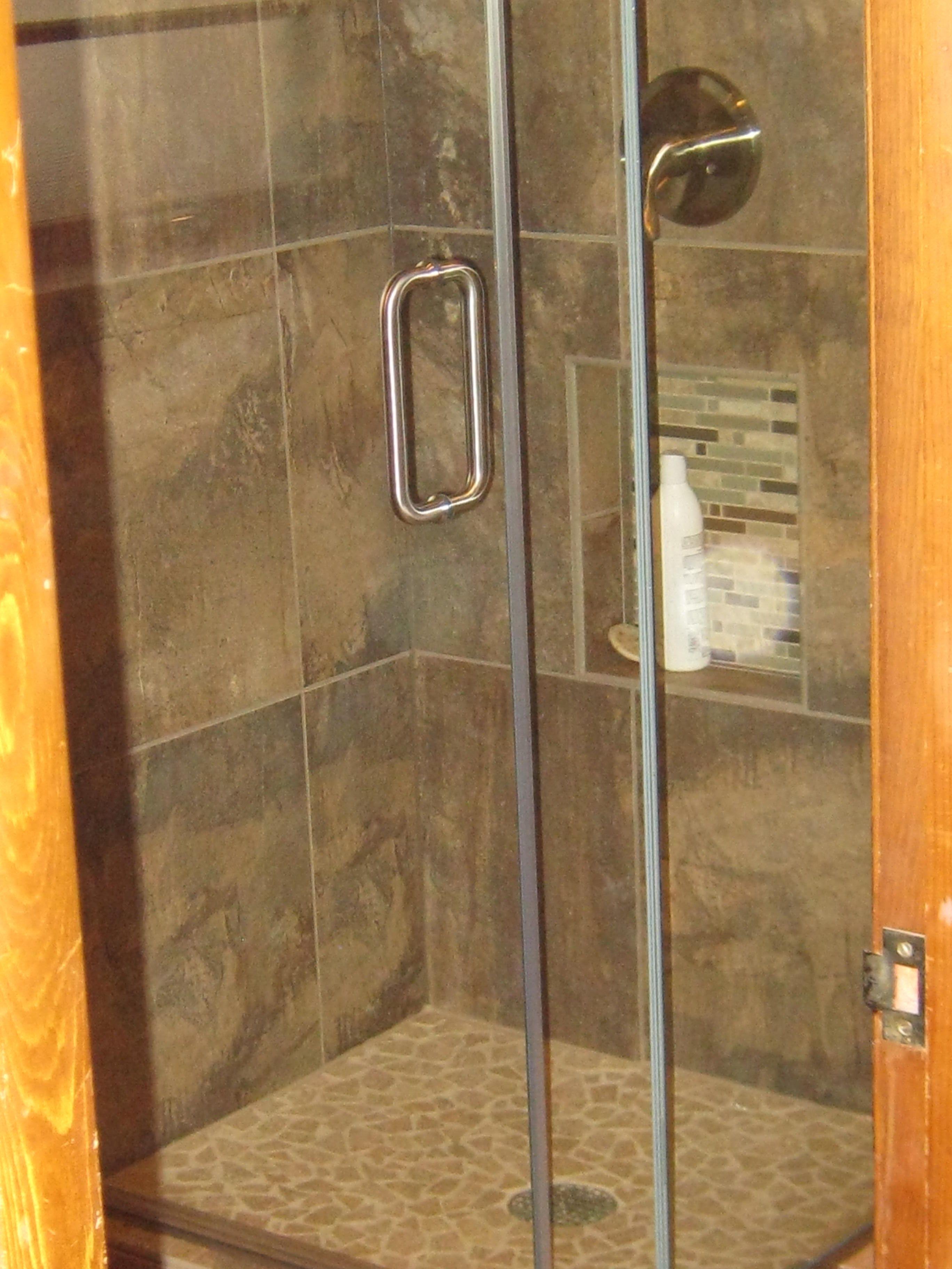 Custom tile corner shower with pepple stones as shower base. Custom ...