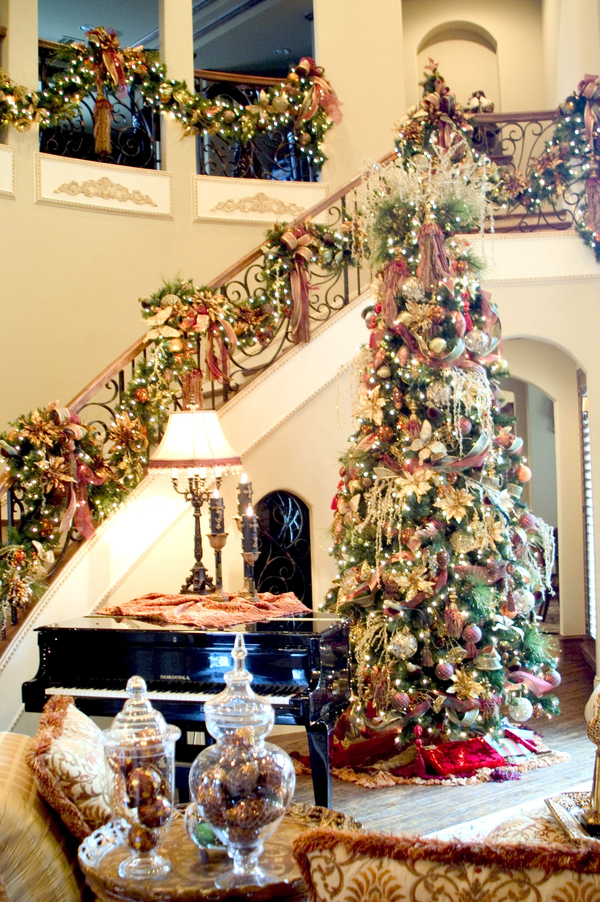 ... elegant high Christmas tree filled with lots of beautiful ornaments and  stunning staircase handrails decor. Must See: Amazing Home Interior  Designing ...