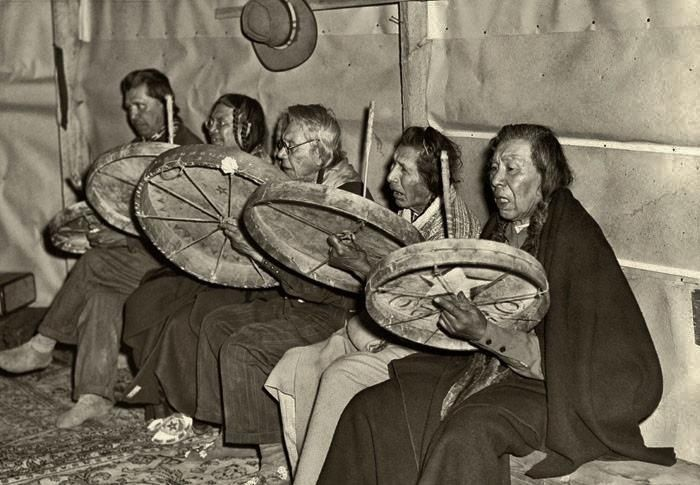 Singers/Drummers at the Feast of the First Salmon, Celilo Falls, Columbia River, Wasco-Wishram, 1945.