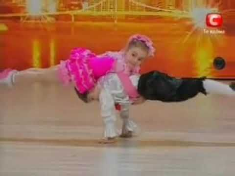 Two children dance in a talent contest and do some amazing acrobats