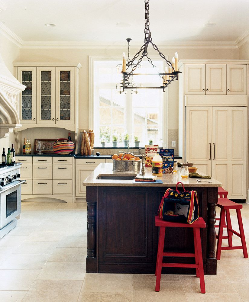 ivory kitchen with black island and russet red stools, dark red ...