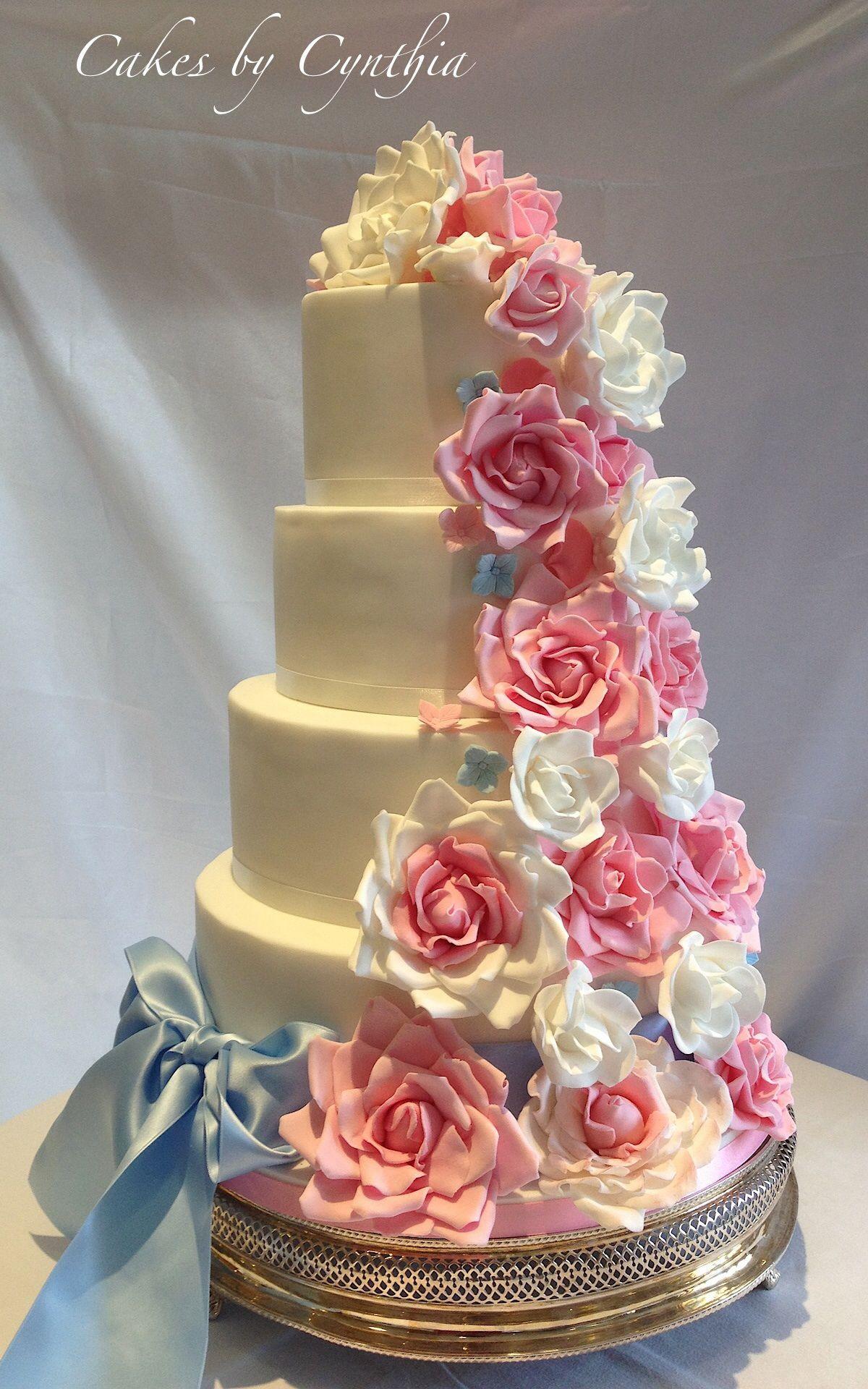 vintage 4 tier wedding cake with pastel rose cascade. wedding