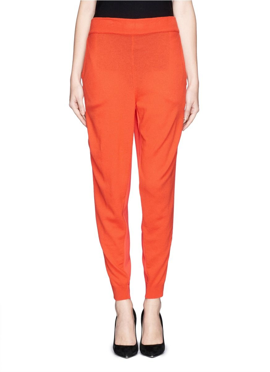 Stella McCartney delivers the utmost sophistication with her play on mixed materials in the new season's collection. These jogging pants combine a luxuriously soft knit wool front with a stretch cady back, making them stylish and interesting from all angles.