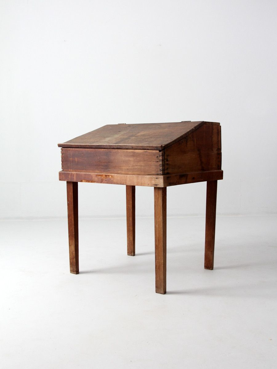 circa This is an antique slant top desk. The natural wood desk features a  slanted flip top. The front of the desk has dovetail joints and primitive  nails. - Circa 1800s This Is An Antique Slant Top Desk. The Natural Wood Desk