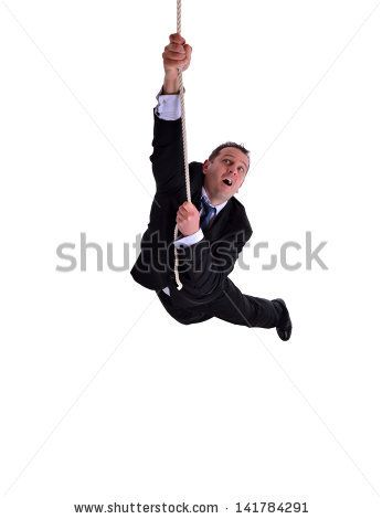 image of a businessman hanging on a rope. Isolated on white
