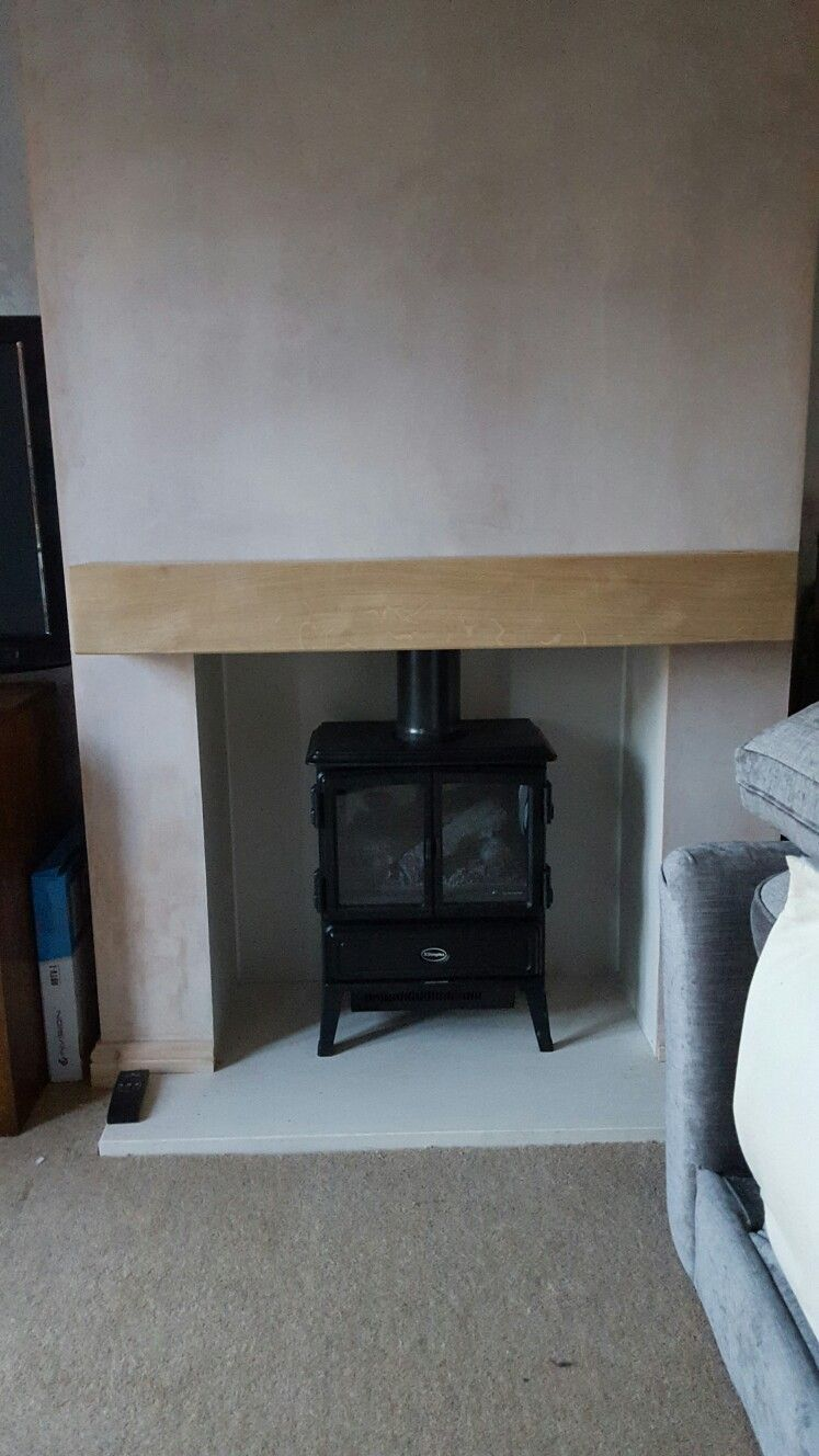faux chimney breast and electric stove fireplace for the home