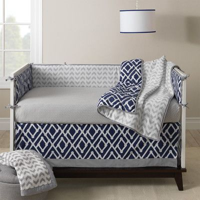 Lambs & Ivy Jensen Crib Bedding Collection.  Prefer this simple peaceful crib set with decorations on the walls and in the room.  Love the grey, navy and white--so versatile. Skip the dangerous bumper and comforter.