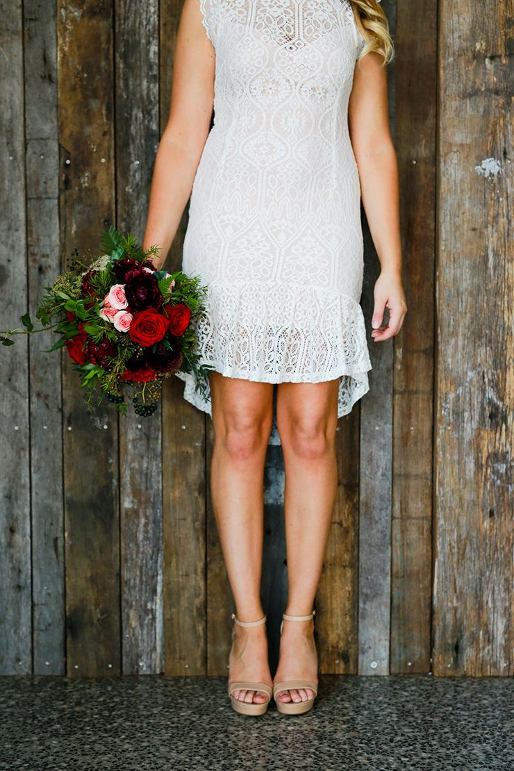 Country lace wedding dress with boots  Rustic Berry Wedding Inspiration  Berry wedding Red rose bouquet