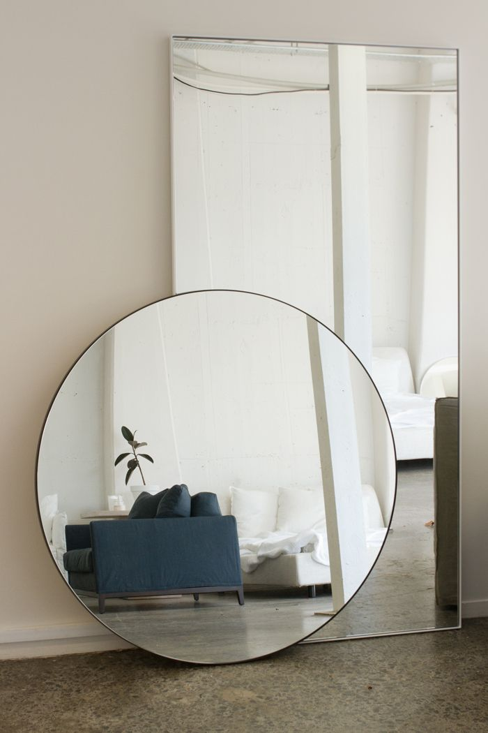 layered mirrors on the floor