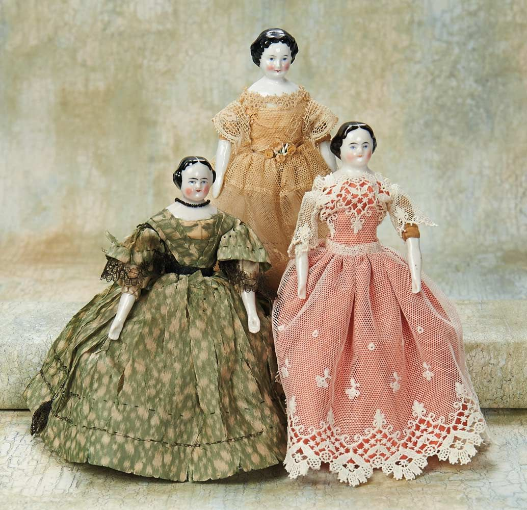 """Theriault's Antique Doll Auctions - Three German Porcelain Dollhouse Dolls - 7"""" Each has porcelain shoulder head with black sculpted hair,painted features,muslin body,porcelain lower limbs,and each is wearing pretty antique costume. Germany,circa 1875."""