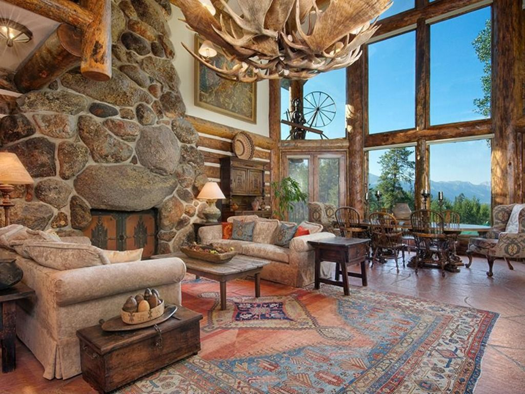 Large stones create a grand living room fireplace.... I want to ...