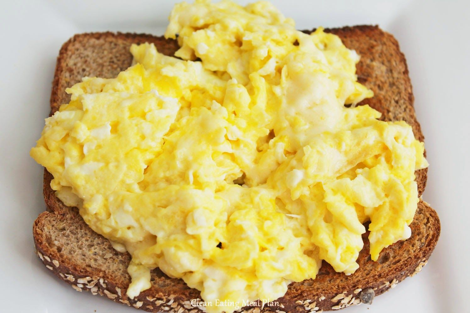 Healthy Breakfast Scrambled Eggs With All Natural Colby Jack Cheese And Real Butter Over Whole Wheat Toast