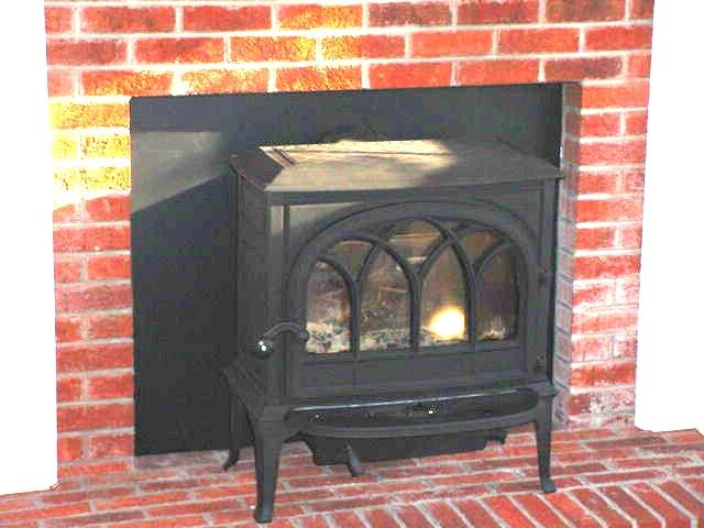 Wood stove installation in front of a fireplace. | House Ideas ...