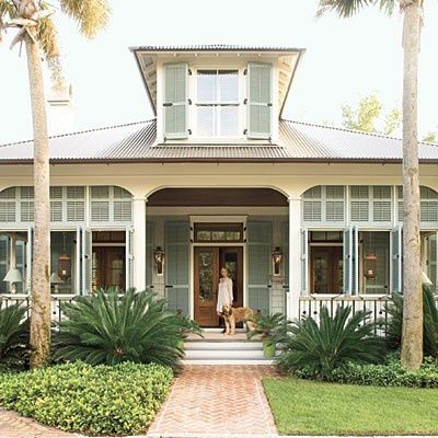 Shutters on this porch add a Coastal Island style to this cottage.