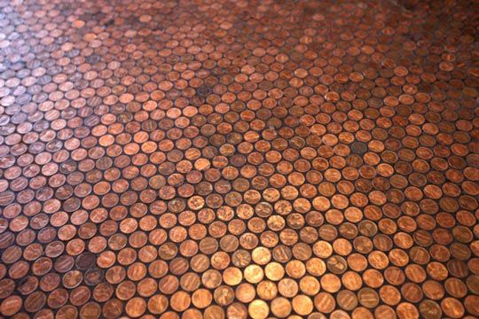 """To the people who asked how I did it-  First, I created a 12"""" x 16"""" template of a repeating """"dot"""" pattern in illustrator sized to match the size of pennies, I glued the template a piece of cardboard and laminated the whole thing (with clear packing tape)   Then I bought some polyester netting and laid it on top of the template and started glueing. I used magna-tac glue because it dried quickly and the pennies didn't pop off because if it's rubbery texture. after the glue dried, I cut off the…"""