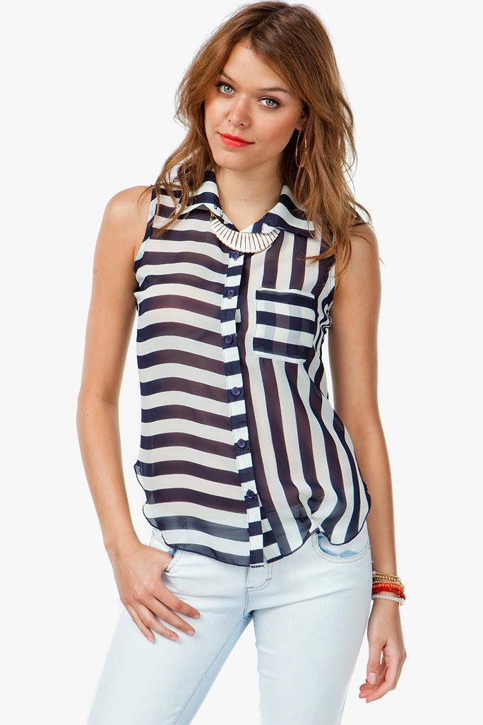 Packed with mixed stripes, this crazy shirt packs quite the punch! Button front closure. Sheer chiffon body. Chest pocket.