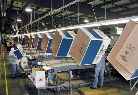 Automatización del sistema de manejo de cajas vacías mejora la eficiencia en empacadoras de manzana