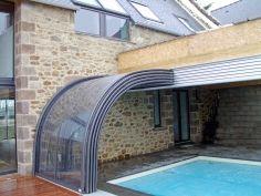 Pool ideas indoor outdoor retractable pool enclosure sun for Indoor pool with retractable roof