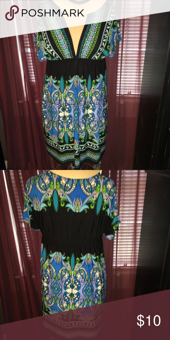 Short Dress black multi blue & green V Neck Boutique - short black multi blue and green dress , v-neck. Size Large. Great for any occasion. Day or night, dance the night away or any day event. Very comfortable. Wear it as is or add a belt! . 95% polyester, 5% spandex. Delusional Dresses Midi