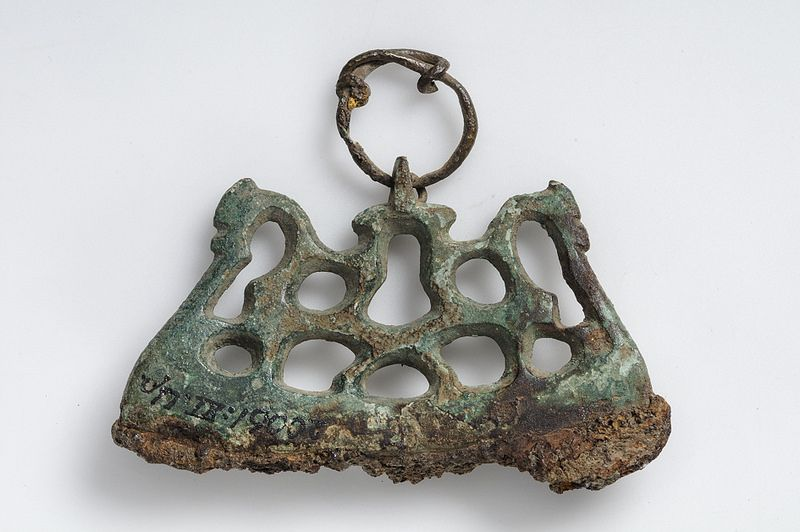 Fire steel  Iron and bronze     The fire steel has openwork bronze casting that depicts equestrian figures.     Grave find, Tuna, Alsike, Uppland, Sweden. SHM 20061:XI