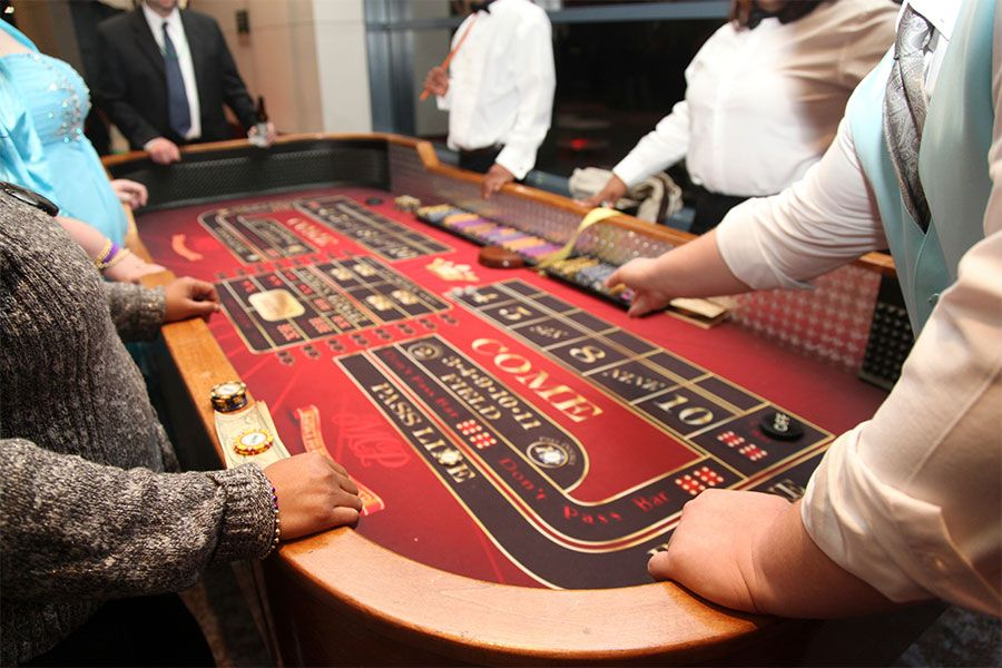 Casino type games set up on oneside of the ball room for
