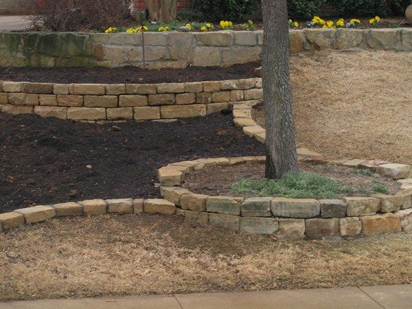 Stone And Wood Retaining Wall