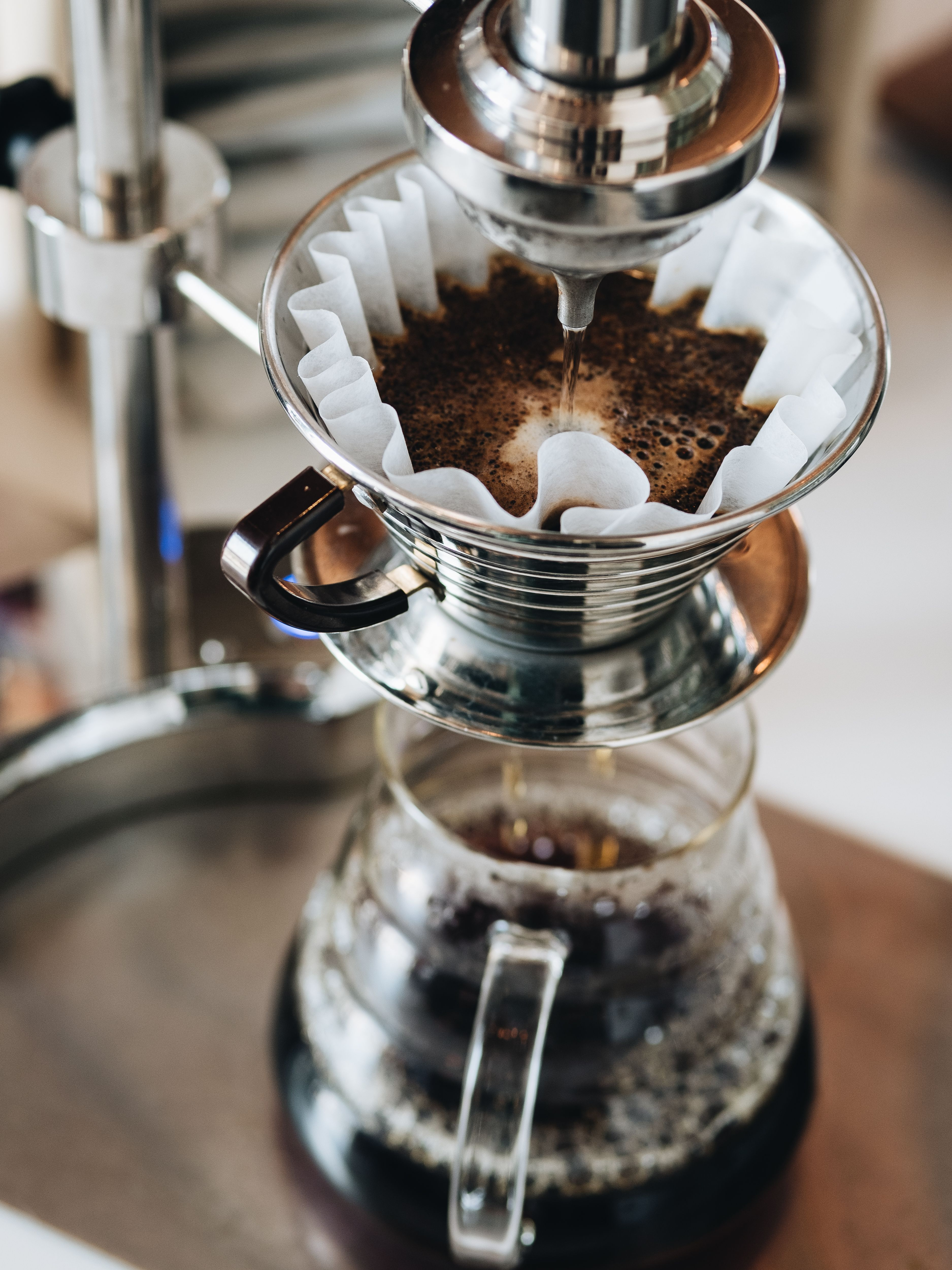 Pour over coffee brewing setup with specialty coffee at
