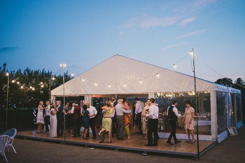 outdoor timber dance floor festoon lighting marquee wedding