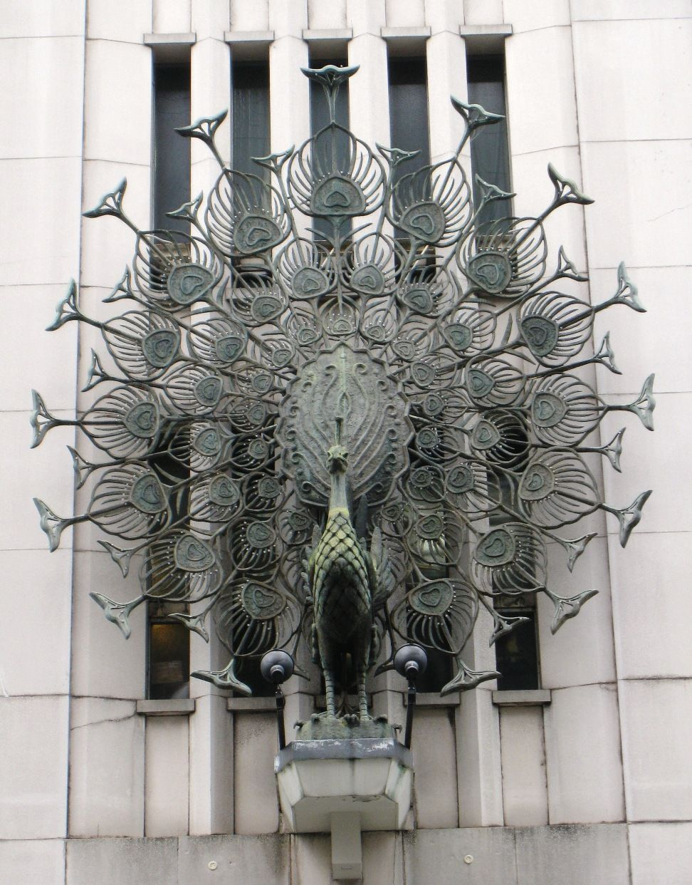 Stunning Cast Peacock On Building Peacock