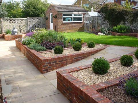 Ramp To Upper Level Sloped Garden Garden Wall Designs Backyard Landscaping Designs
