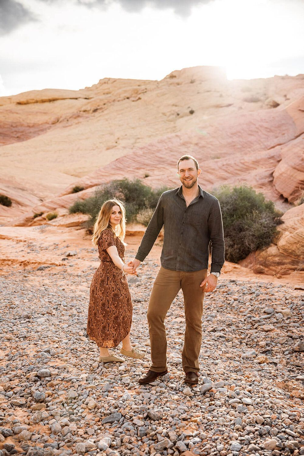 Couple standing in dry river bed in Valley of Fire State