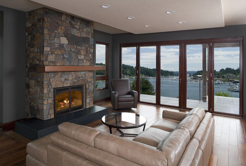 Glass patio doors allows expansive water views in this for Sliding glass walls for patios