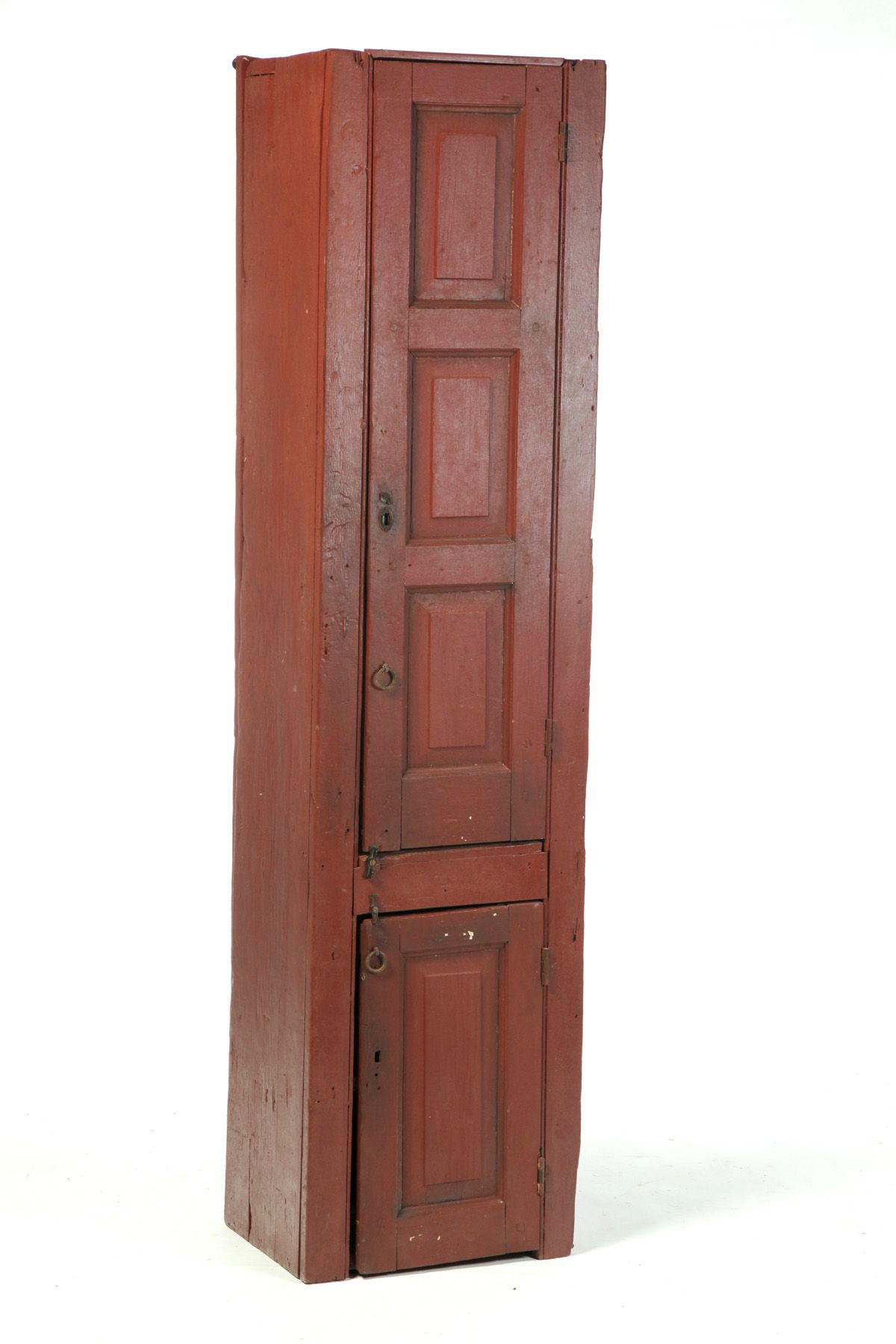 AMERICAN PAINTED CHIMNEY CUPBOARD. Attributed To The Shakers, 19th Century,  Pine. One Piece Cupboard With Two Raised Panel Doors, And Red Paint.