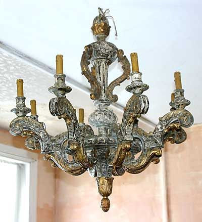 Italian, painted and parcel-gilded six-light chandelier: In solid, carved wood.  Late 19th or early 20th century.