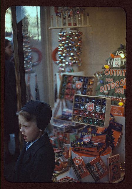 1941   [Boy beside store window display of Christmas ornaments] (LOC) by The Library of Congress, via Flickr