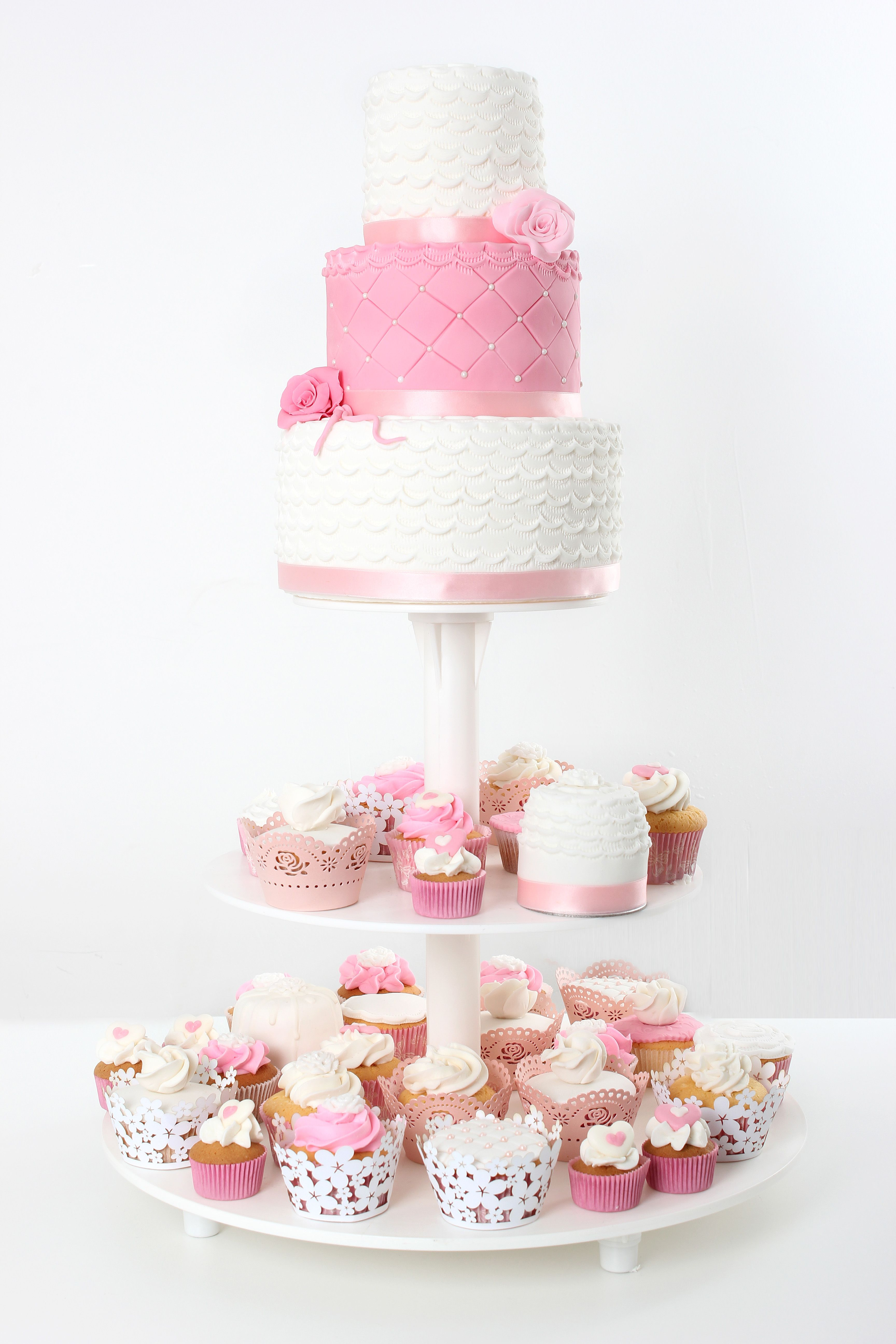 mini cakes, wedding cake and cupcakes - A pink and white wedding ...